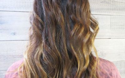 Loose, beachy curls make this sun-kissed color pop!