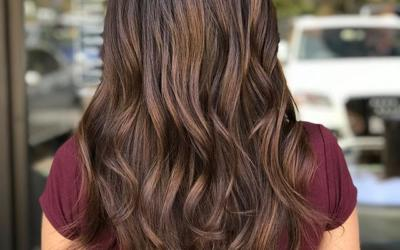 Back to naturals for this bomb shell brunette.